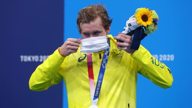 游泳选手颁奖礼上摘口罩  违反奥运防疫规定