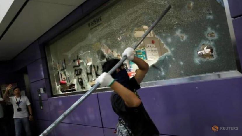 Protesters smash Hong Kong's Tung Chung MTR station, set fire to barricades