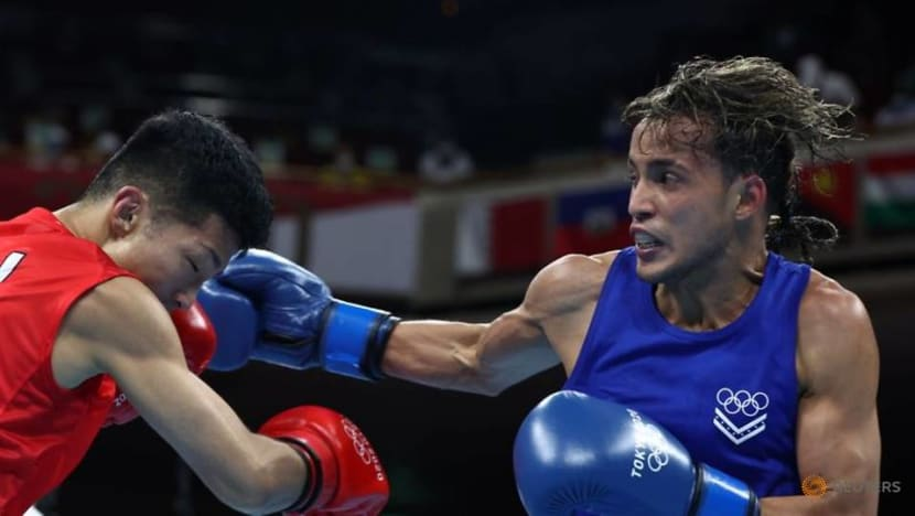 Olympics-Boxing-Uzbek Zoirov begins title defence with routine win