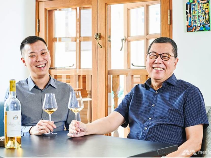 Who is the father-and-son team behind one of Singapore's top wine distributors?