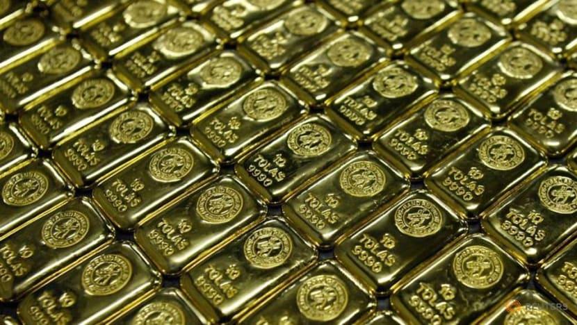 Gold scales record peak as gloomy economic outlook bolsters appeal