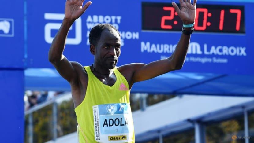 Ethiopian Adola digs deep to win Berlin marathon, Bekele third
