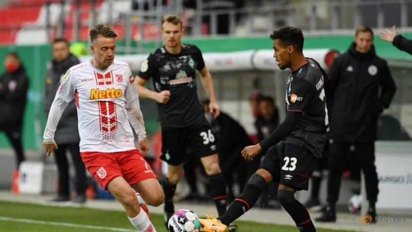 Football: Werder battle past Regensburg to reach German Cup semis