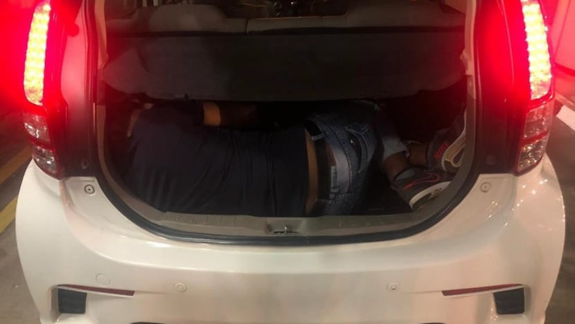 Two Malaysians arrested for attempting to smuggle man out of Singapore in car boot