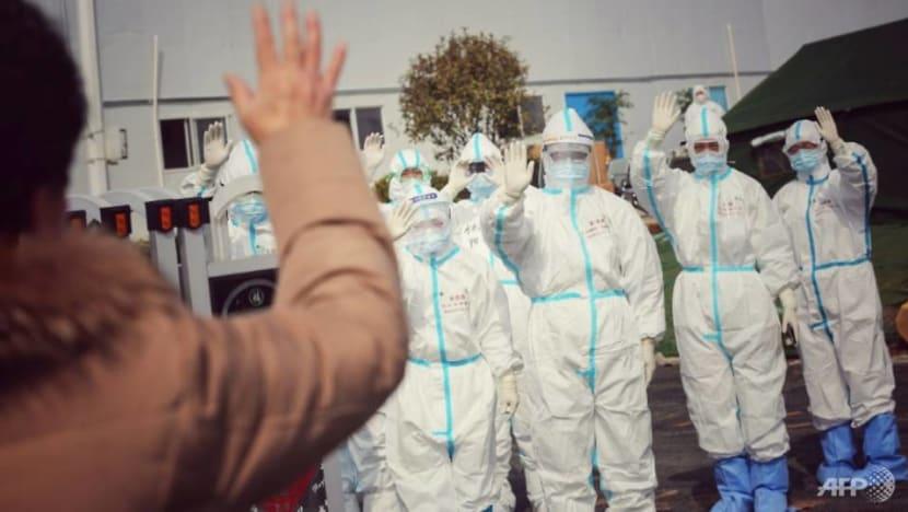 China sees fewer coronavirus cases, wary of international travelers