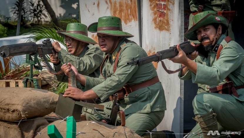 Wooden swords and replica rifles: History buffs in Indonesia recreate battles to honour national heroes
