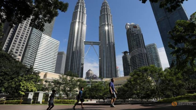 Kuala Lumpur businesses open up cautiously on first day after government eases COVID-19 restrictions