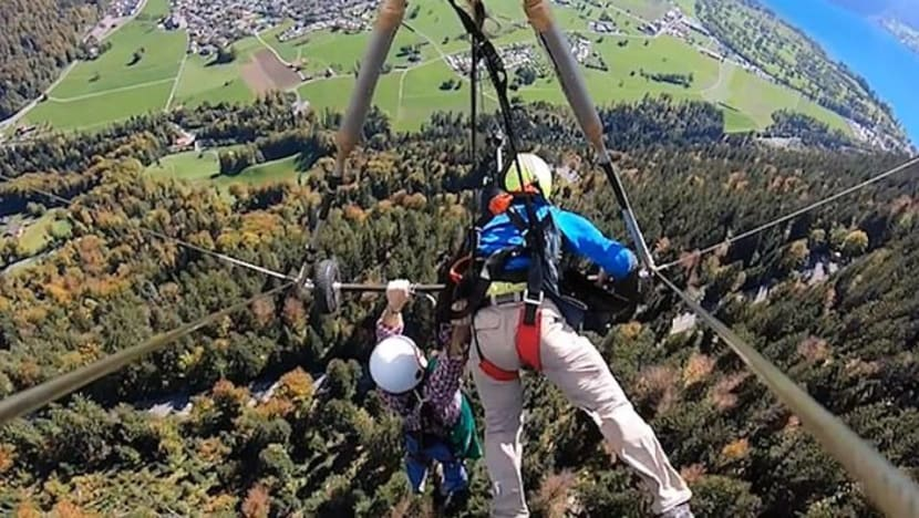 Man has near-death experience while hang gliding after pilot forgets to secure his harness