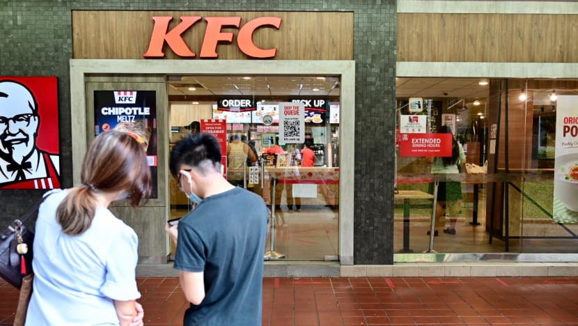 KFC tells customers to hold off on the 'finger lickin' for now