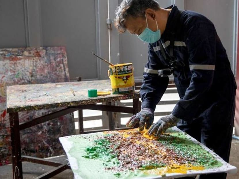 Philippine artist fights waste by using recycled trash in paintings