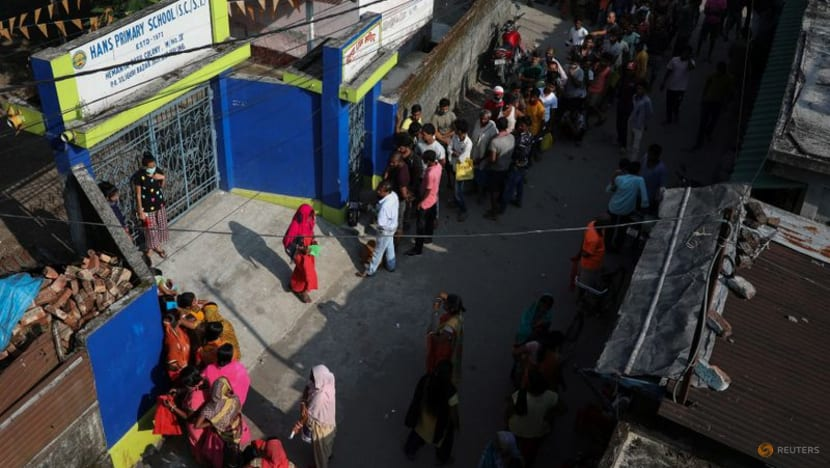 Midnight vigils, snaking queues as some Indians await COVID-19 vaccines