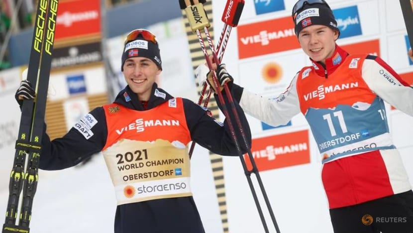Riiber sprints to claim Nordic combined gold for Norway