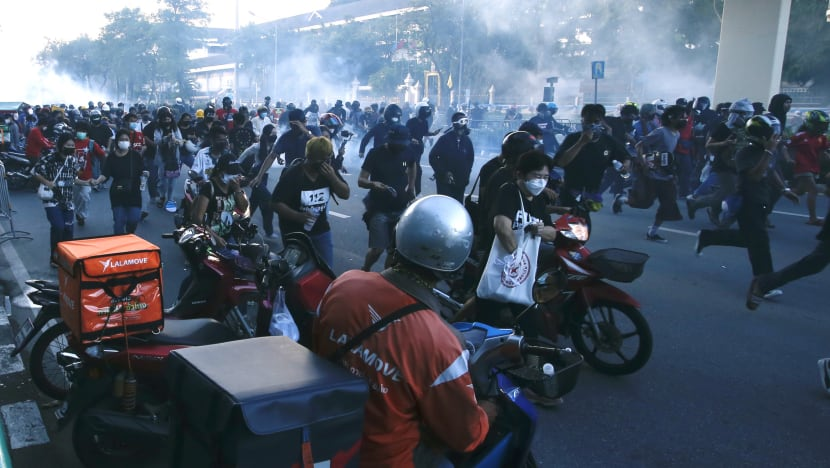 Thai police use water cannon to tackle protest against PM