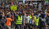 Melbourne police break up violent anti-vaccine protest with pepper spray, rubber pellets