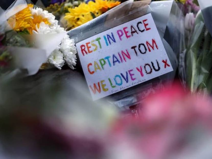 With tears and flowers, Britain mourns 'hero' Captain Tom Moore
