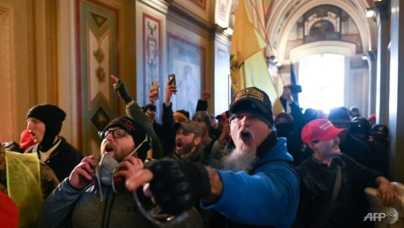 Guns and tear gas in US Capitol as Trump supporters attempt to overturn his loss