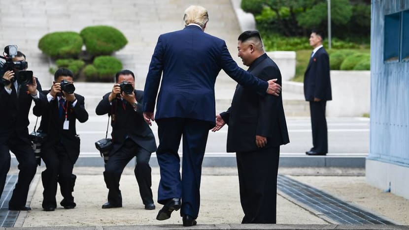 Trump holds historic meeting with Kim with a tweet, handshake and 'flowers of hope'