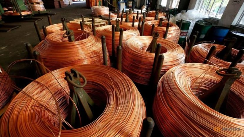 Asia factories see momentum weaken on rising costs, new COVID-19 curbs