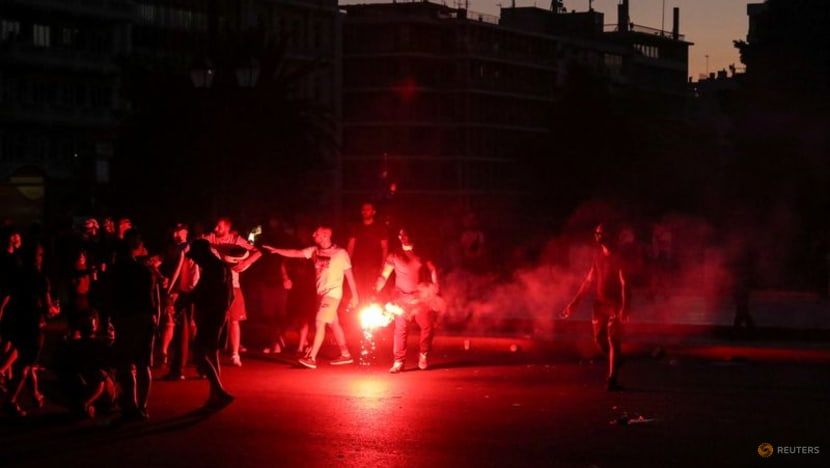 Greek police use tear gas, water canon during Athens COVID-19 vaccine protest