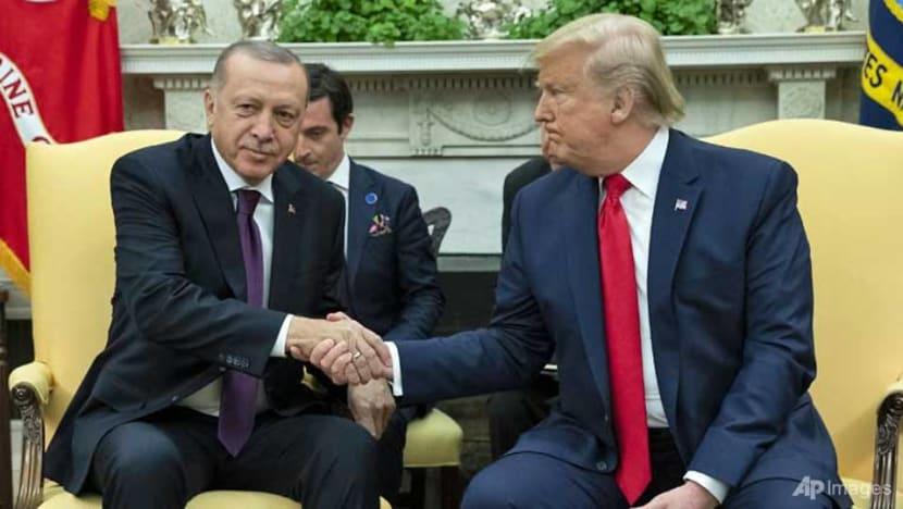 Trump ignores impeachment to host Turkey's Erdogan