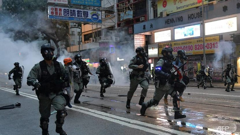 Petrol bombs and tear gas rock Hong Kong, scores arrested for defying mask ban