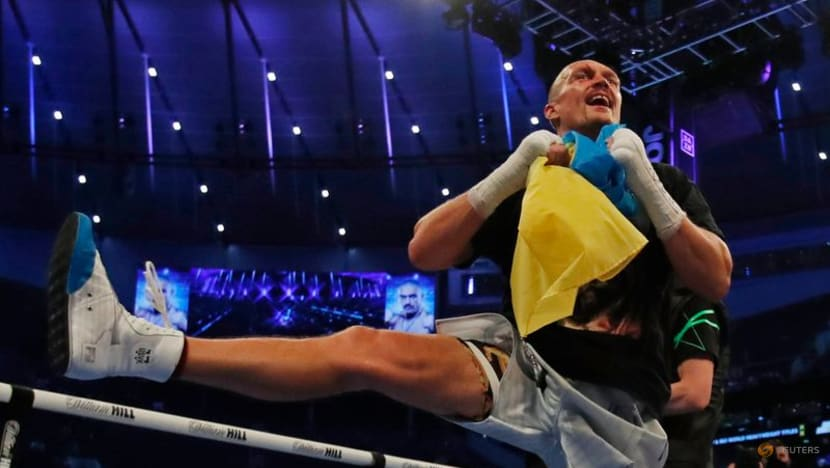Boxing-Usyk says heavyweight title can't compare with Olympic gold
