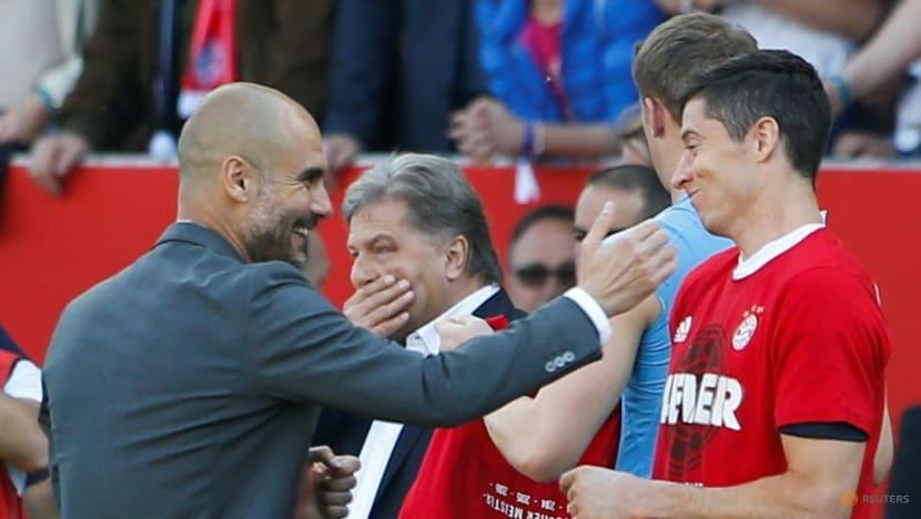 Soccer-Guardiola laughs off Lewandowski question, happy with City squad