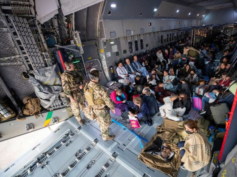 Evacuations from Afghanistan gather momentum as Taliban promise peace
