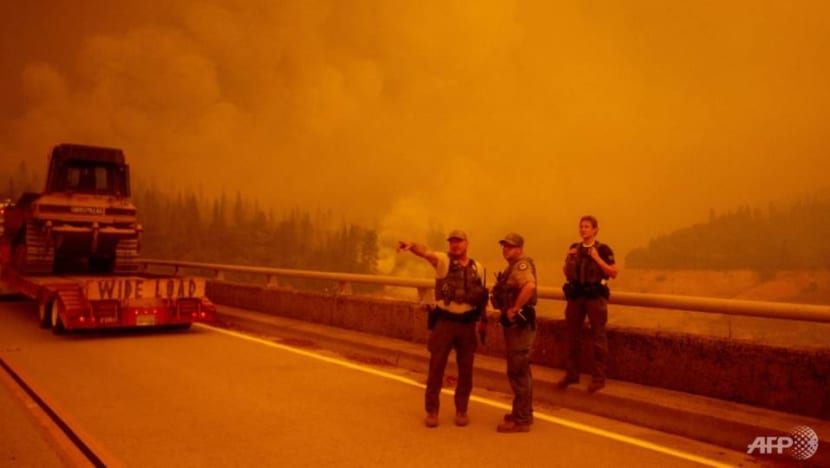 As wildfires rage, US voters still divided on climate