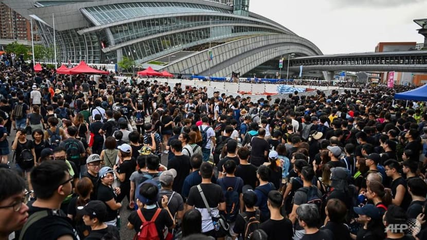 Hong Kong protesters flood West Kowloon train station in rally against controversial extradition Bill