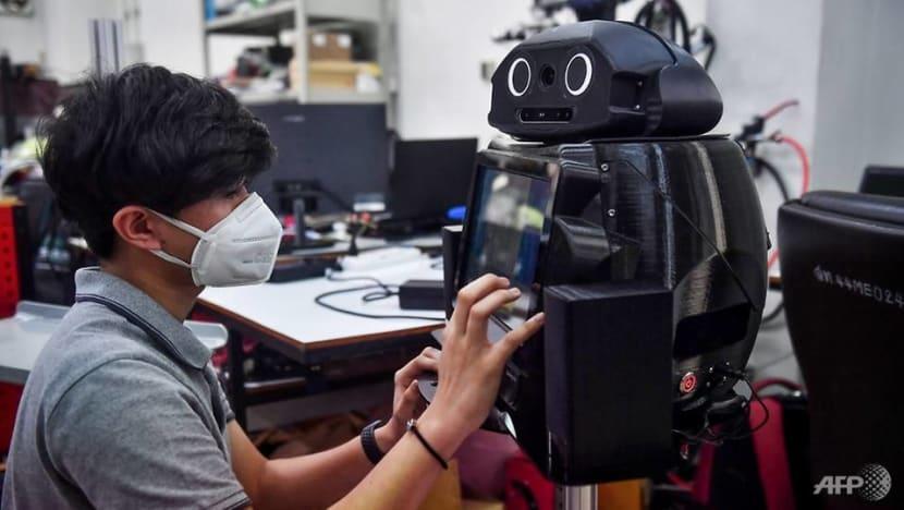 Thai hospitals deploy 'ninja robots' to aid virus battle