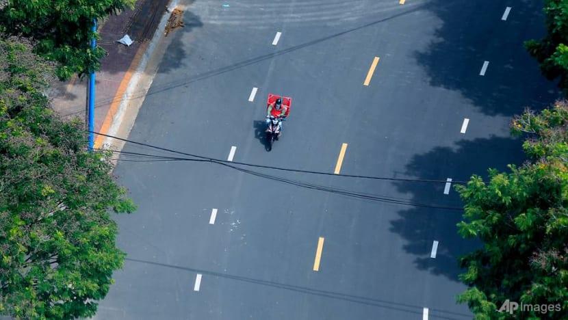 Vietnam puts southern region in lockdown as COVID-19 surge grows