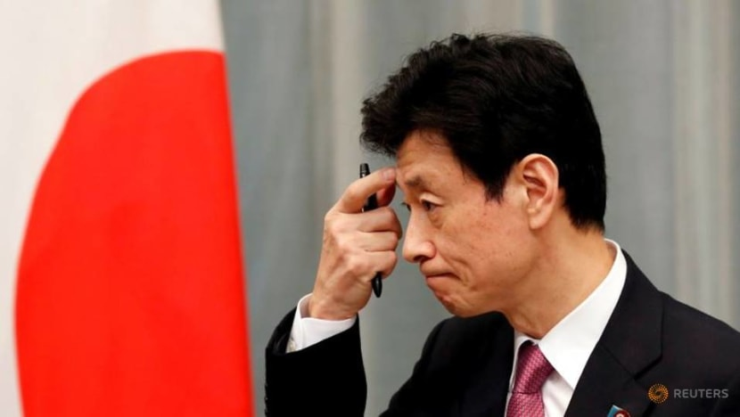 Japan economy minister defends his job after COVID-19 lockdown criticism