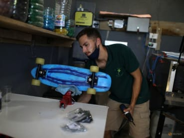 In Brazil favela, skateboards made of bottle caps promote recycling