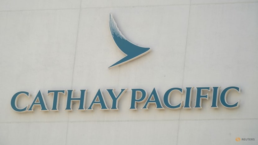 Cathay Pacific's loss shrinks in first half, risks to overseas slots flagged