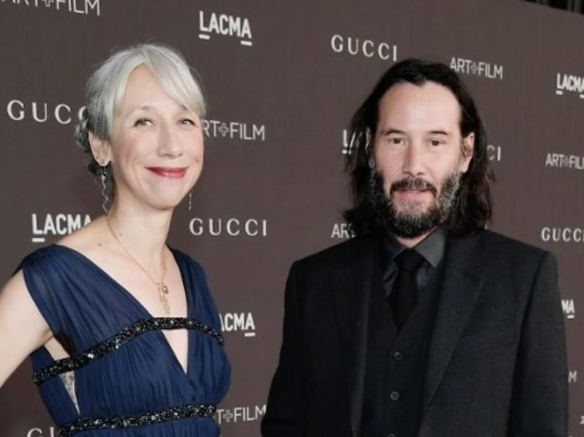 Keanu Reeves sparks girlfriend rumours after holding hands with artist at LA event
