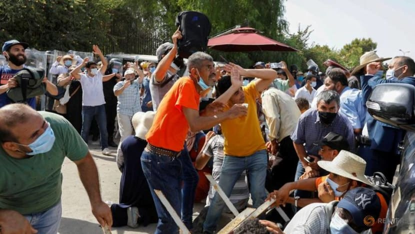 Clashes in Tunisia after president ousts PM amid COVID-19 protests
