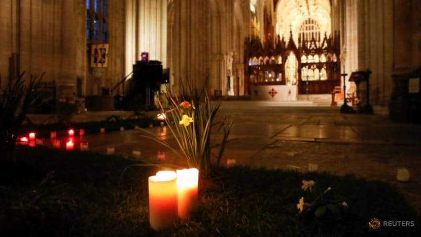 One year from first lockdown, Britain grieves more than 126,000 COVID-19 dead