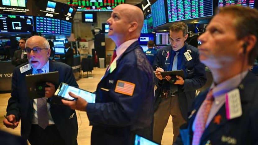 US stocks gain on ECB stimulus, trade war moderation