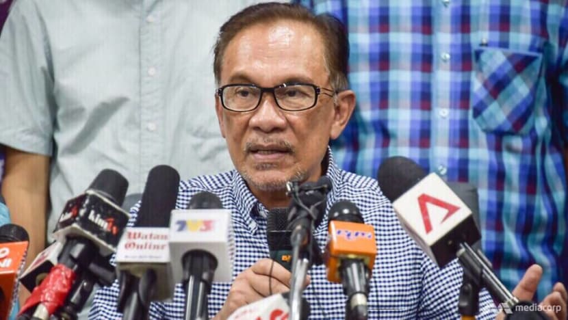 Anwar Ibrahim 'shocked' by arrest of aide over sex video implicating Malaysian minister