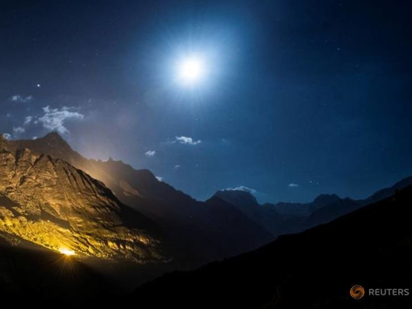 Swiss mountains light up in a national day celebration to suit COVID-19 era