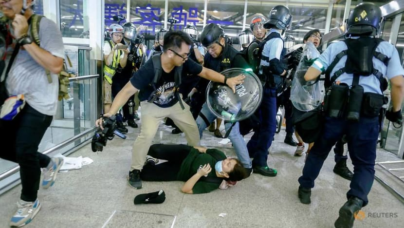 Chaos erupts at Hong Kong airport as protesters clash with police