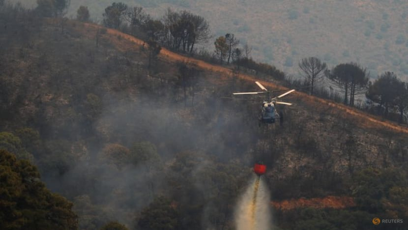 Wildfire raging in Spain forces more than 900 to flee, a firefighter dies