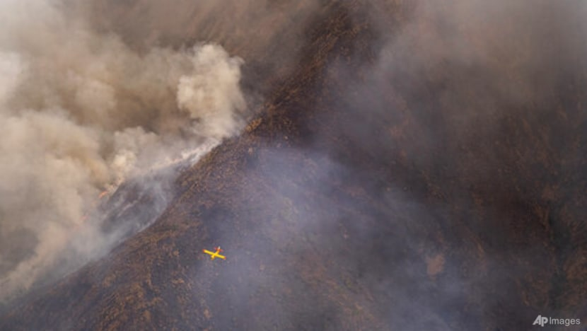 Rainfall helps firefighters control southern Spain's inferno