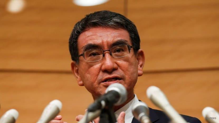 Japan's vaccines minister Kono leads opinion poll on succeeding Suga