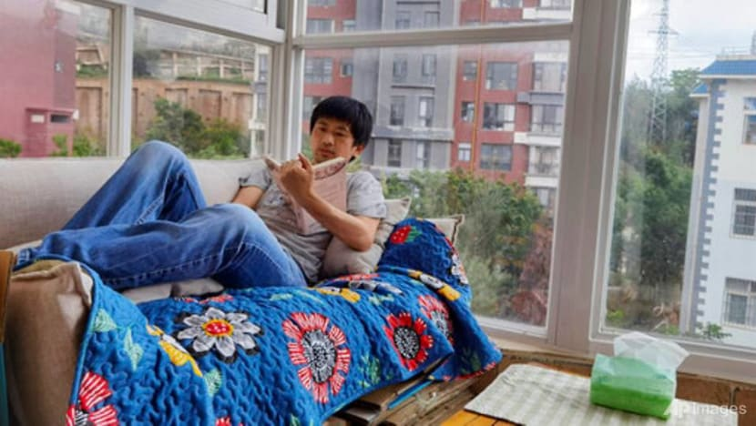 Some Chinese shun gruelling careers for 'low-desire life'
