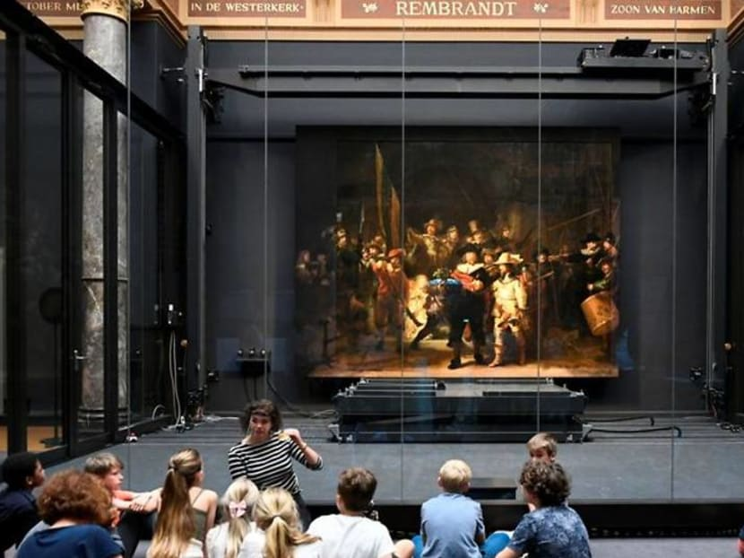 Rembrandt's 'Night Watch' on display with missing figures restored by AI
