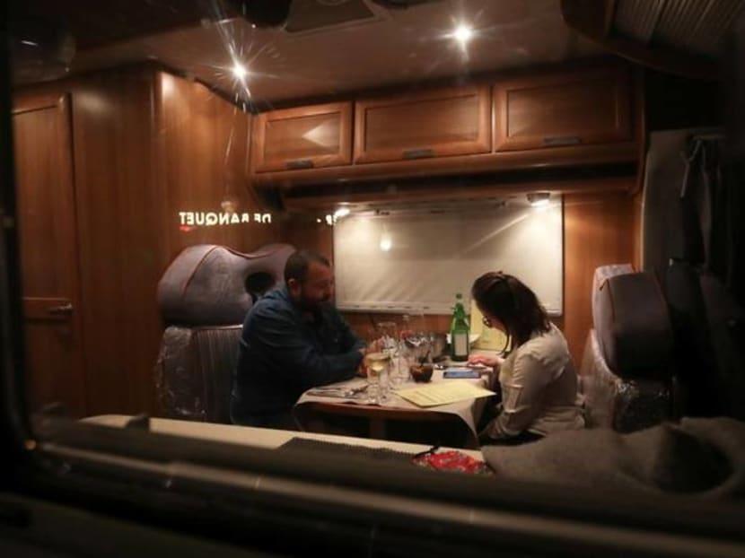 Meals on wheels: Camper van dining beats lockdown rules in Belgium