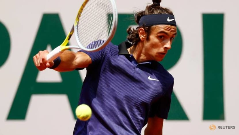 Tennis-Djokovic through after huge scare as Musetti retires