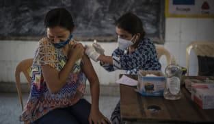 India celebrates 1 billion COVID-19 vaccine doses with song and dance
